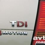 Rdeči D in I pomenita neposredni vbrizg goriva po novem sistemu črpalka-šoba (PD) in 85 kW moči. 4Motion pa štirikolesni pogon s sklopko haldeks.